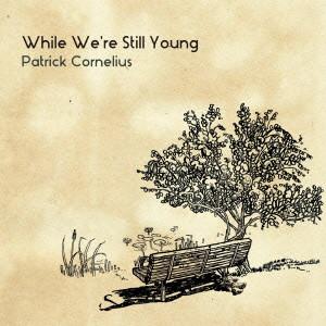 パトリック・コーネリアス/ホワイル・ウィ・アー・スティル・ヤング